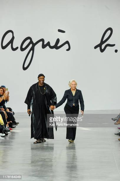 Oxmo Puccino and Designer Agnes B walk the runway during the Agnes B Womenswear Spring/Summer 2020 show as part of Paris Fashion Week on September 30...