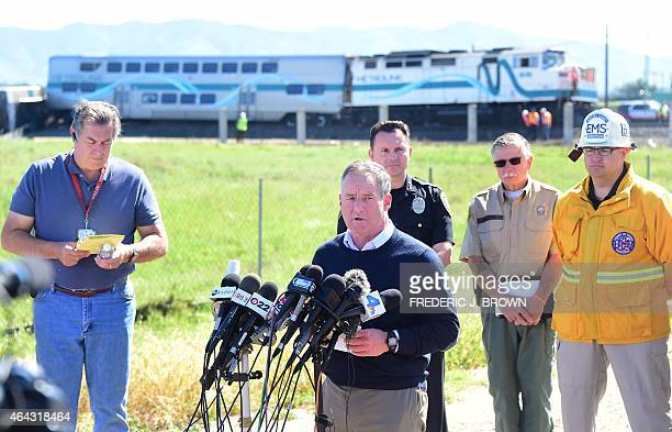 Oxnard Mayor Tim Flynn briefs the media beside railway tracks where a truck was hit by a Los Angelesbound Metrolink train during the early morning...
