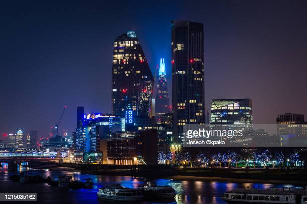 Oxo Tower, Sea Containers London and The Shard are lit up blue to show appreciation and support for NHS staff during the COVID-19 outbreak March 26,...