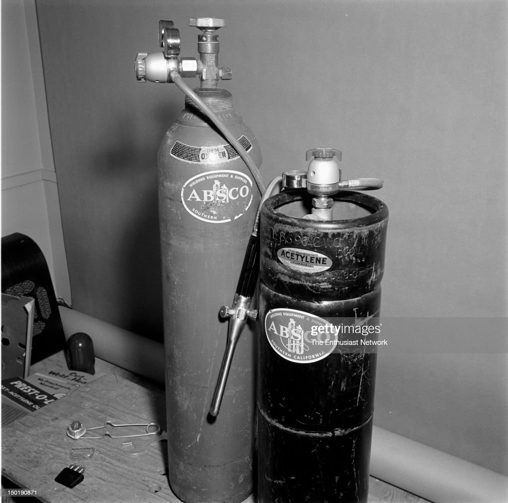 Oxy-Acetylene welding bottles, hoses, and torch on elevated