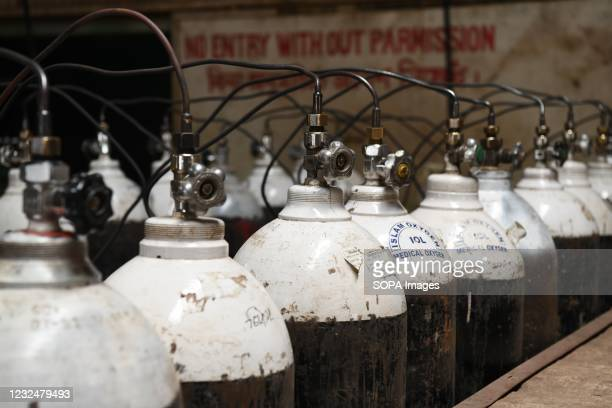 Oxygen cylinders being refilled at an oxygen plant. Supply of medical oxygen to public hospitals is under strain as the demand for the...
