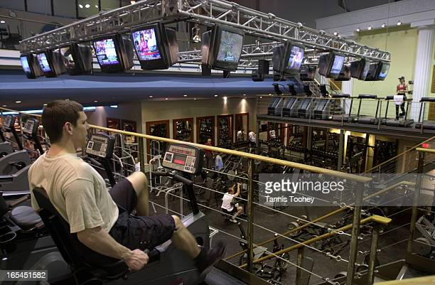 May 31 2002Oxygen fitness club shot from the cardio level looking down onto the weigths area with television for clients to watch This club is in an...