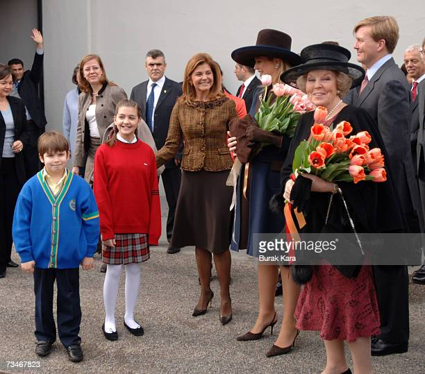Oya Eczacibasi Founder of Istanbul Modern Art Museum greets Princess Maxima of the Netherlands Queen Beatrix of the Netherlands and Prince...