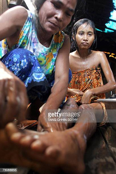 Rochom Soy wouldbe mother of a Cambodian missing girl Rochom P'ngieng gives her a bath in her house at Oyadao district in Rottanakiri province some...