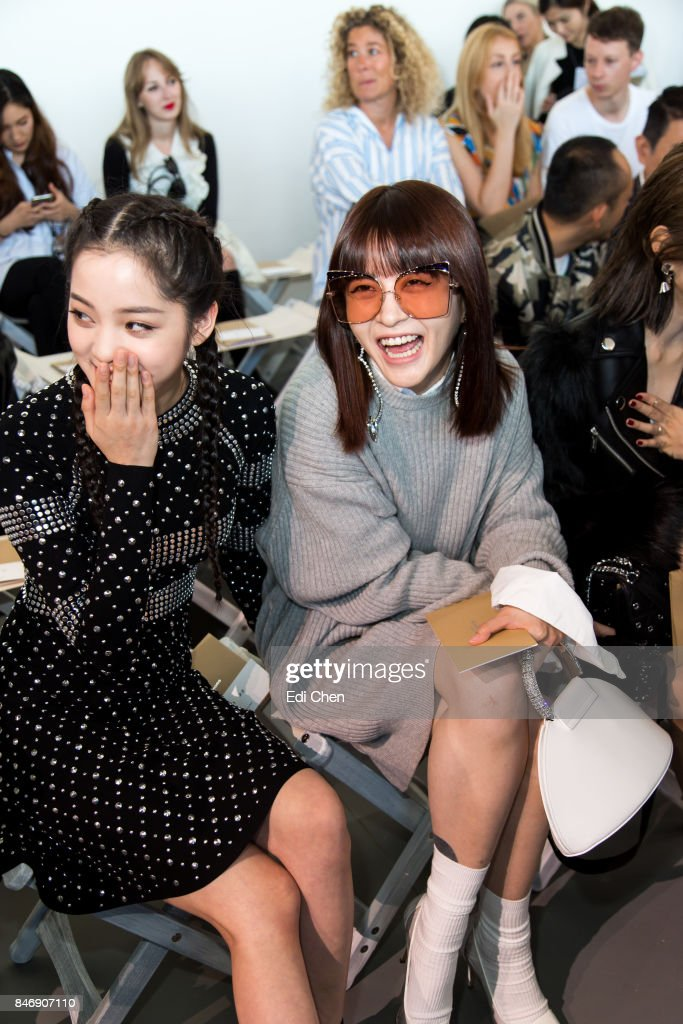 Oyang Nana & Fil Xiaobai attend the Michael Kors runway show during New York Fashion Week at Spring Studios on September 13, 2017 in New York City.
