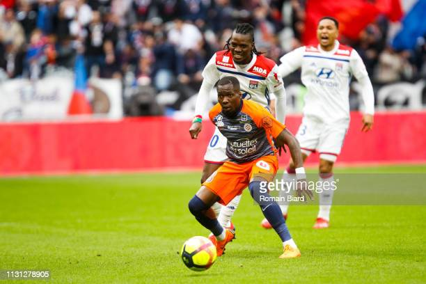 Oyongo Bitolo Ambroise of Montpellier and Traore Bertrand of Lyon during the Ligue 1 match between Lyon and Montpellier at Groupama Stadium on March...