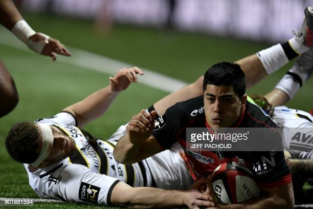Oyonnax' Argentinian wing Axel Muller celebrates as he scores a try during the French Top 14 rugby union match between Oyonnax and La Rochelle at The...