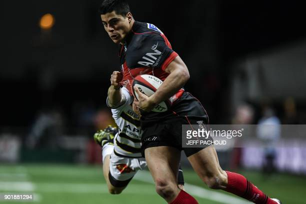 Oyonnax' Argentinian wing Axel Muller is tackled by La Rochelle's French wing Gabriel Lacroix during the French Top 14 rugby union match between...