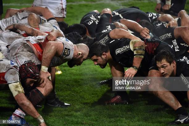 Oyonnax' Georgian prop Irakli Mirtskhulava vies with Toulouse's French hooker Julien Marchand in the scrum during the Top 14 rugby match Stade...