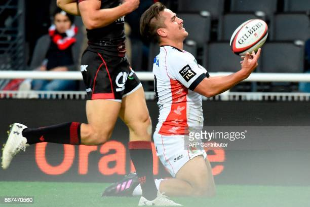 Oyonnax' New Zealander flyhalf Benjamin Botica celebrates after scoring a try during the French Top 14 rugby union match between Lyon and Oyonnax at...