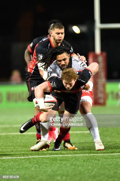 Oyonnax' South African scrumhalf James Hall is tackled by Toulon's New Zealand center Ma'a Nonu with the ball during the French Top 14 rugby union...