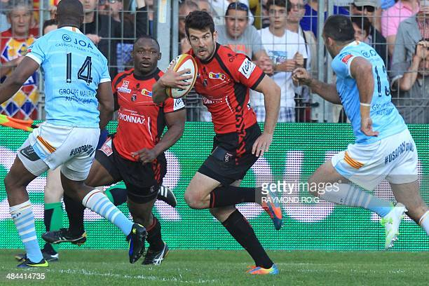 Oyonnax's numbereight Benjamin Urdapilleta runs with the ball during the French Top 14 rugby union match between Perpignan and Oyonnax at the...
