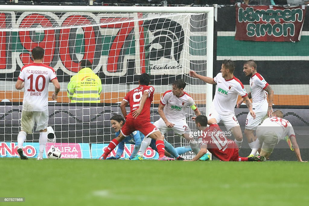oYoshinori Muto (#9) of Mainz scores the 3rd team goal during the Bundesliga match between FC Augsburg and 1. FSV Mainz 05 at WWK Arena on September 18, 2016 in Augsburg, Germany.