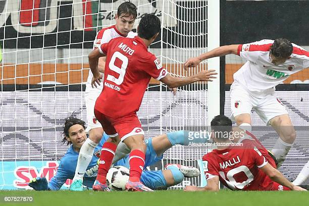 oYoshinori Muto of Mainz scores the 3rd team goal during the Bundesliga match between FC Augsburg and 1 FSV Mainz 05 at WWK Arena on September 18...