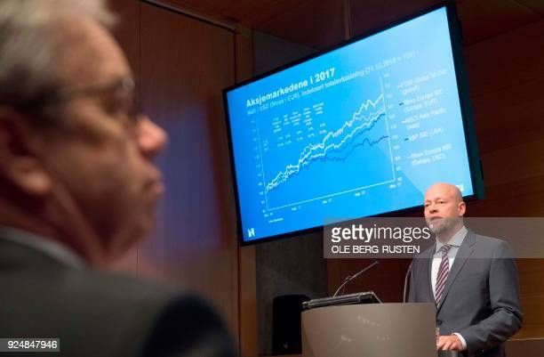 Oystein Olsen Governor of the Central Bank of Norway listens to Yngve Slyngstad CEO of Norges Bank Investment Management as he presents details from...