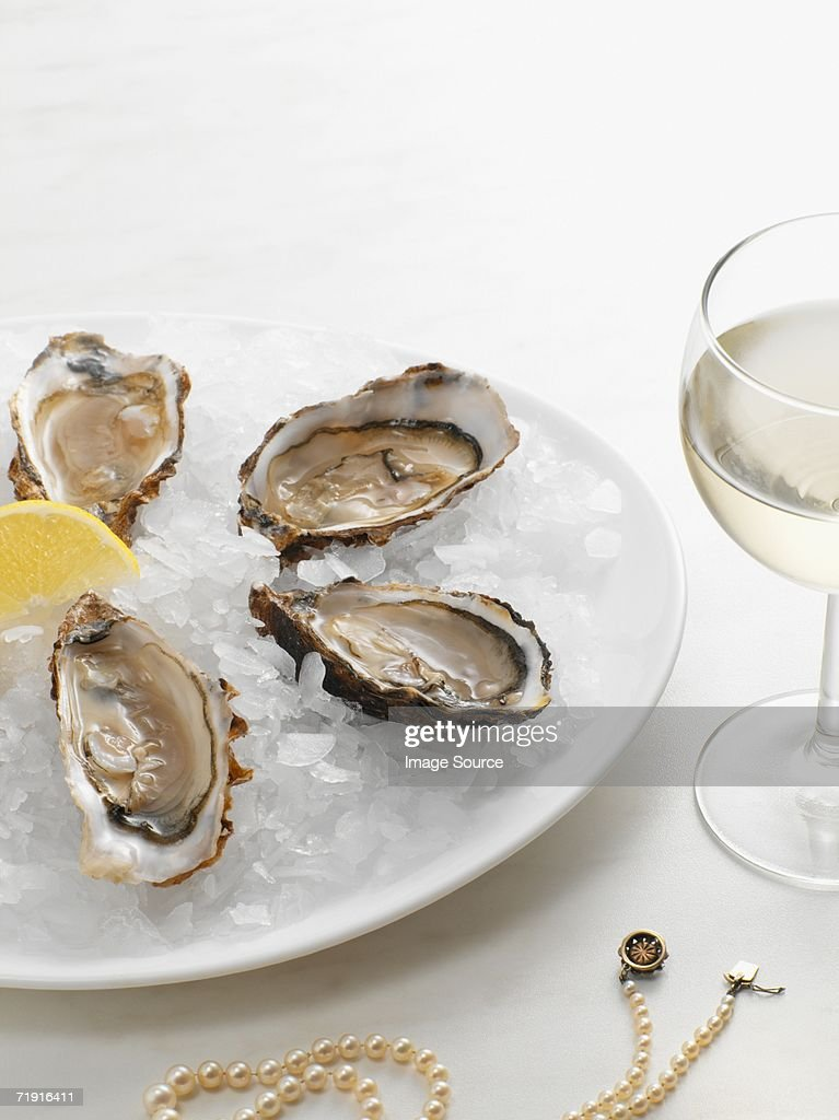 Oyster and pearls : Stock Photo