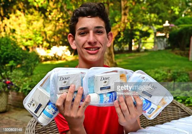 Portrait of 16-year-old James Bodian, at his Oyster Bay, New York home, with some of the sanitizing kits he made, and has been donating to homeless...