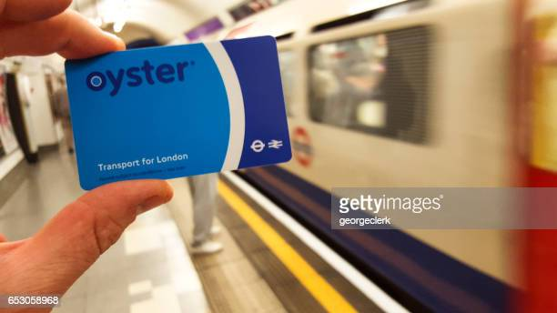 oyster card in london underground station - oyster shell stock photos and pictures