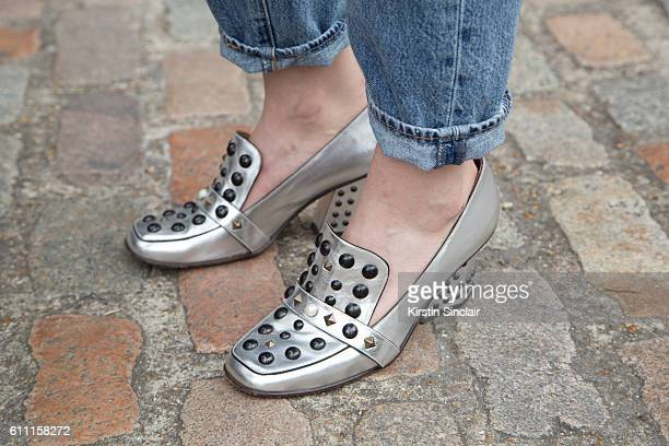Oyster fashion editor Chloe Hill wears Leviu2019s jeans and Coach shoes on day 3 of London Womens Fashion Week Spring/Summer 2016 on September 18...