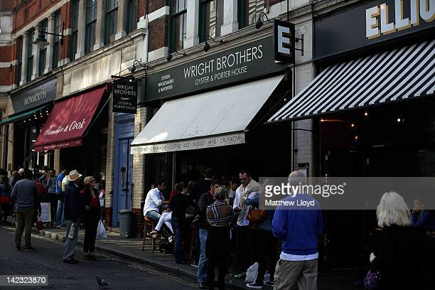 Oyster houses and coffee shops at Borough market on March 24, 2012 in London, England. Borough Market in Southwark is one of London's largest, hugely...