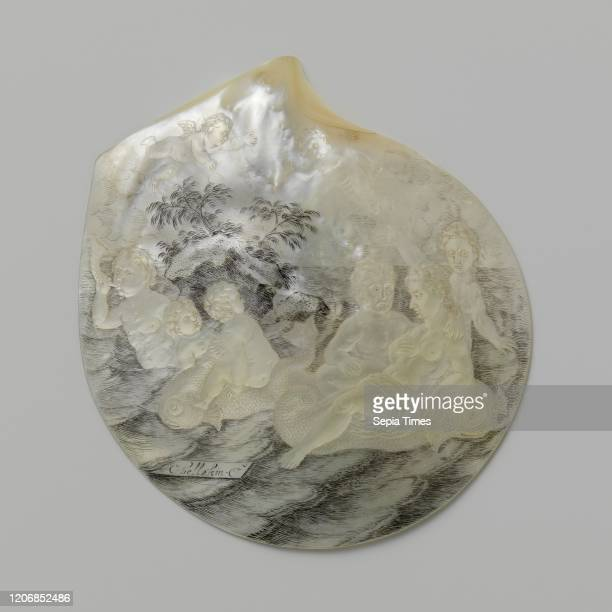 Oyster shell with sea figures and a rock with plants Sea pearls shell one of a few embossed with figures at sea close to a rock with plants engraved...