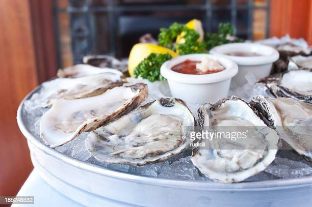 oysters half shell - oyster shell stock photos and pictures