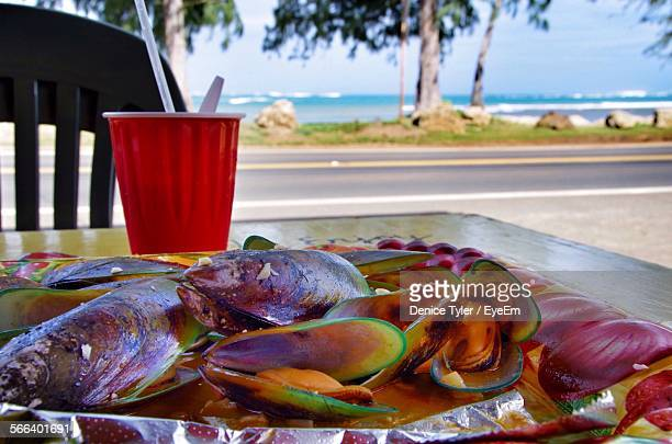 oysters on plate in restaurant - pacific islands stock pictures, royalty-free photos & images