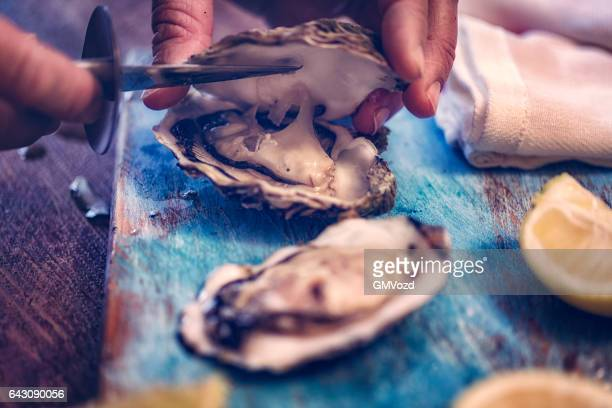 oysters on plate with ice and lemon - fresh seafood stock photos and pictures