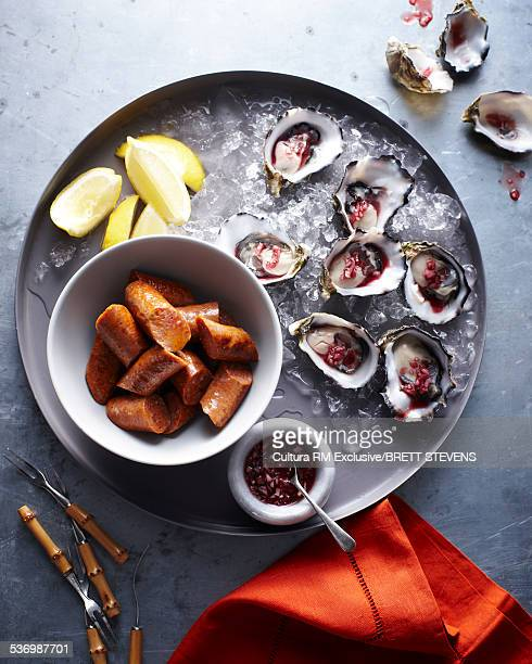 Oysters with shallots and sausages