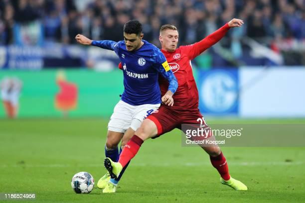 Ozan Kabak of FC Schalke 04 and Rouwen Hennings of Fortuna Dusseldorf battle for the ball during the Bundesliga match between FC Schalke 04 and...