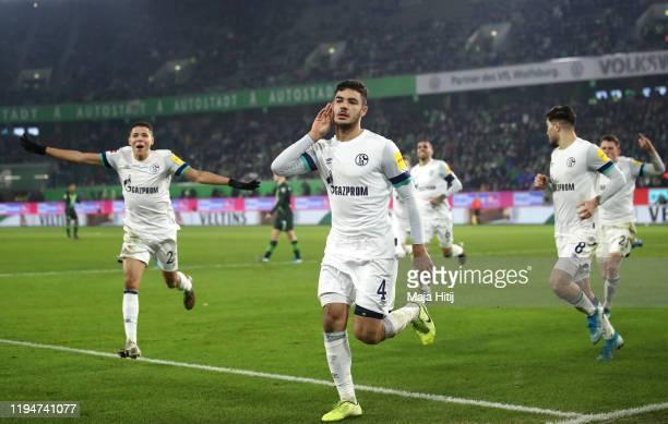 Ozan Kabak of FC Schalke celebrates after scoring his team's first goal during the Bundesliga match between VfL Wolfsburg and FC Schalke 04 at...