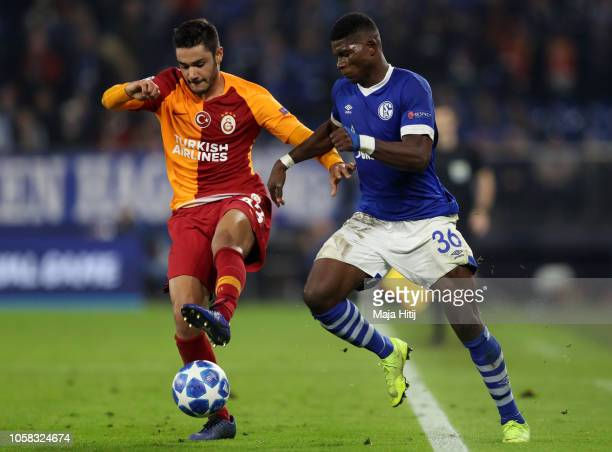 Ozan Kabak of Galatasaray is challenged by Breel Embolo of FC Schalke 04 during the Group D match of the UEFA Champions League between FC Schalke 04...