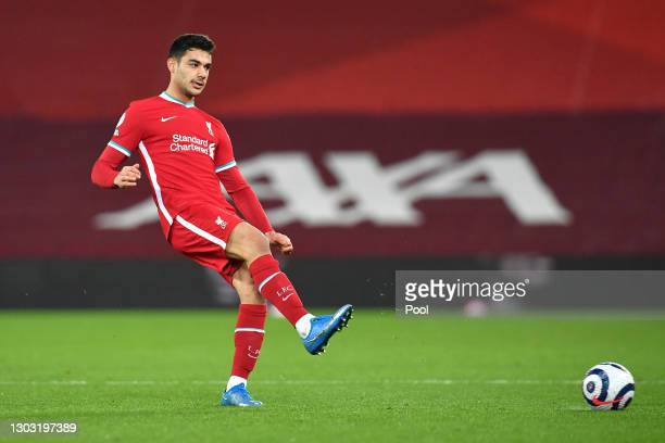 Ozan Kabak of Liverpool passes the ball during the Premier League match between Liverpool and Everton at Anfield on February 20, 2021 in Liverpool,...