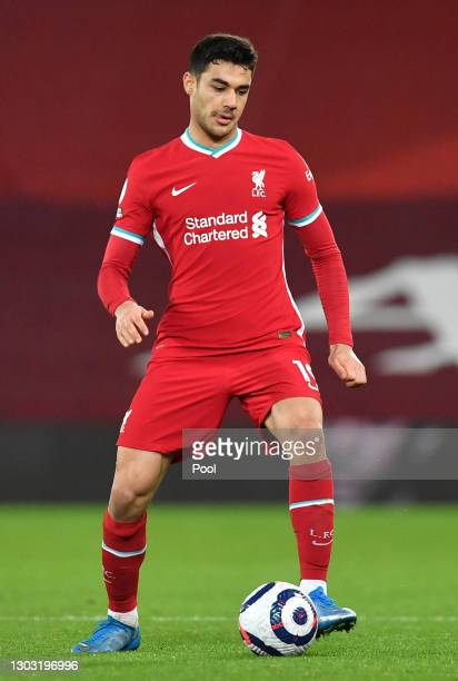 Ozan Kabak of Liverpool runs with the ball during the Premier League match between Liverpool and Everton at Anfield on February 20, 2021 in...