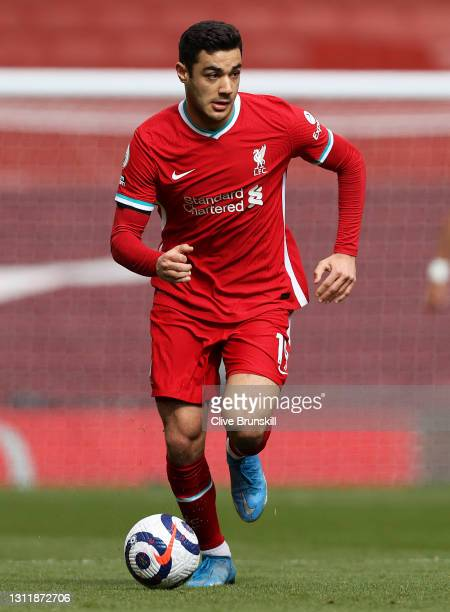 Ozan Kabak of Liverpool runs with the ball during the Premier League match between Liverpool and Aston Villa at Anfield on April 10, 2021 in...