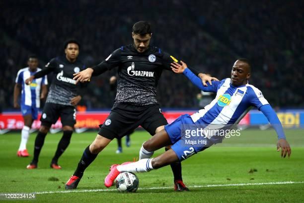 Ozan Kabak of Schalke 04 is tackled by Dodi Lukebakio of Hertha Berlin during the Bundesliga match between Hertha BSC and FC Schalke 04 at...