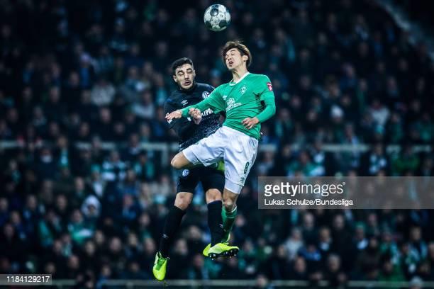 Ozan Kabak of Schalke and Yuya Osako of Bremen in action during the Bundesliga match between SV Werder Bremen and FC Schalke 04 at Wohninvest...