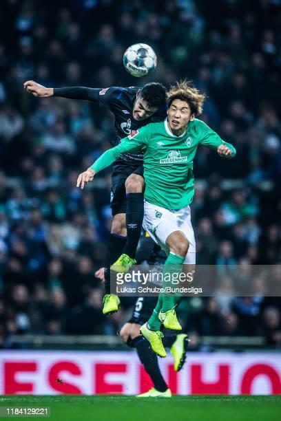Ozan Kabak of Schalke in action against Yuya Osako of Bremen during the Bundesliga match between SV Werder Bremen and FC Schalke 04 at Wohninvest...