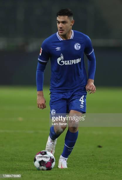 Ozan Kabak of Schalke runs with the ball during the Bundesliga match between Borussia Moenchengladbach and FC Schalke 04 at Borussia-Park on November...