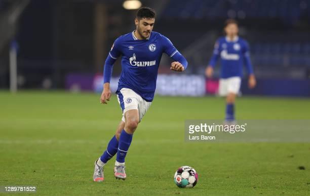 Ozan Kabak of Schalke runs with the ball during the Bundesliga match between FC Schalke 04 and Bayer 04 Leverkusen at Veltins-Arena on December 06,...