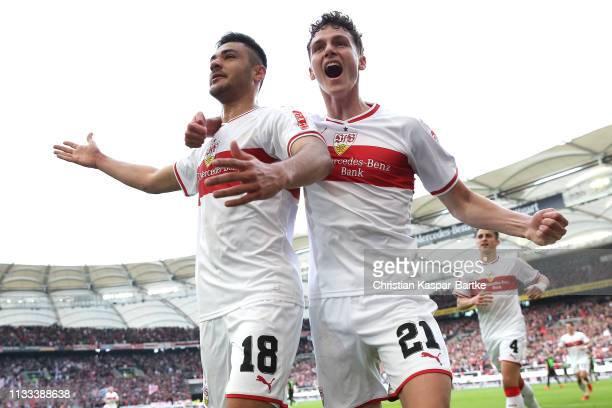 Ozan Kabak of VfB Stuttgart celebrates scoring his sides third goal with Benjamin Pavard during the Bundesliga match between VfB Stuttgart and...