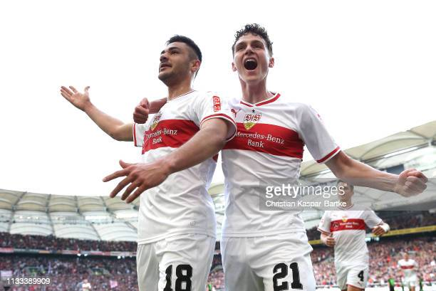 Ozan Kabak of VfB Stuttgart celebrates scoring his sides third goal with Benjamin Pavard during the Bundesliga match between VfB Stuttgart and...