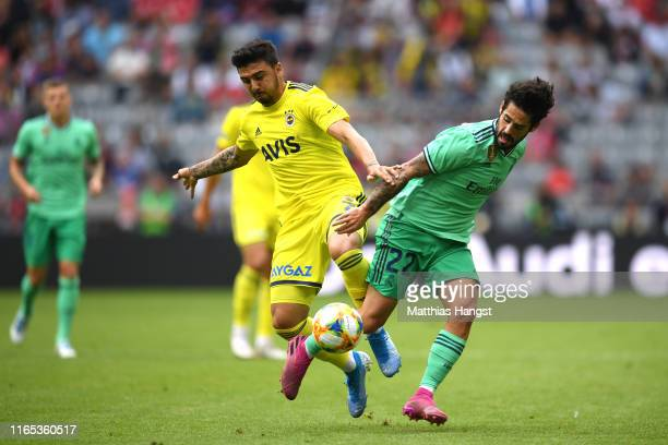 Ozan Tufan of Fenerbache is tackled by Isco of Real Madrid during the Audi cup 2019 3rd place match between Real Madrid and Fenerbahce at Allianz...