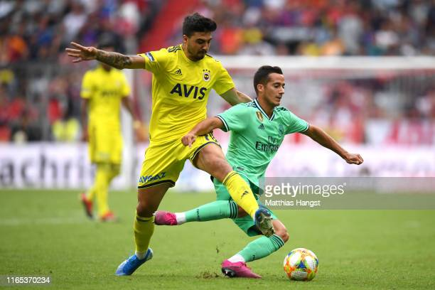 Ozan Tufan of Fenerbache tackles Lucas Vazquez of Real Madrid during the Audi cup 2019 3rd place match between Real Madrid and Fenerbahce at Allianz...