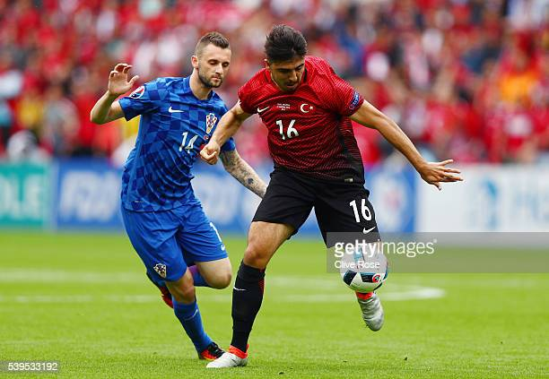 Ozan Tufan of Turkey and Marcelo Brozovic of Croatia compete for the ball during the UEFA EURO 2016 Group D match between Turkey and Croatia at Parc...