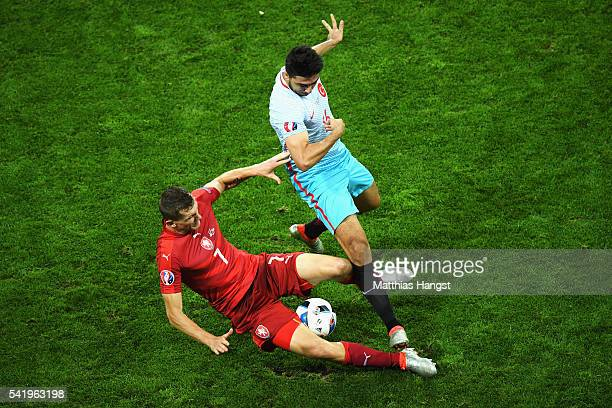 Ozan Tufan of Turkey and Tomas Necid of Czech Republic compete for the ball during the UEFA EURO 2016 Group D match between Czech Republic and Turkey...