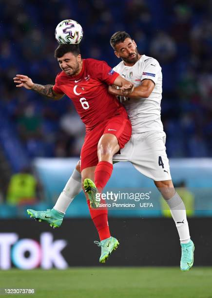 Ozan Tufan of Turkey battles for a header with Leonardo Spinazzola of Italy during the UEFA Euro 2020 Championship Group A match between Turkey and...