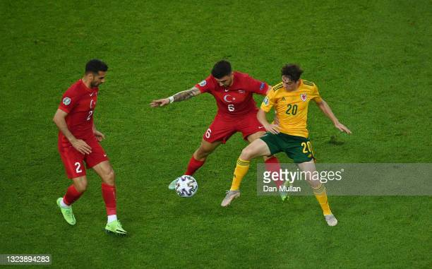 Ozan Tufan of Turkey battles for possession with Daniel James of Wales during the UEFA Euro 2020 Championship Group A match between Turkey and Wales...