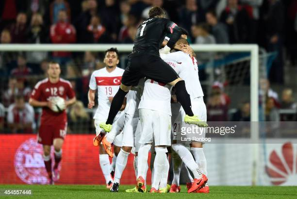 Ozan Tufan of Turkey celebrates with team mates after scoring their second goal during the international friendly between Denmark and Turkey at...