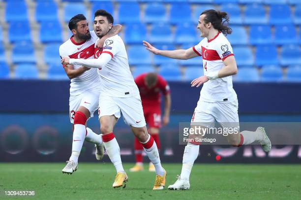 Ozan Tufan of Turkey celebrates with Umut Merao and Caglar Soyuncu after scoring their team's third goal during the FIFA World Cup 2022 Qatar...